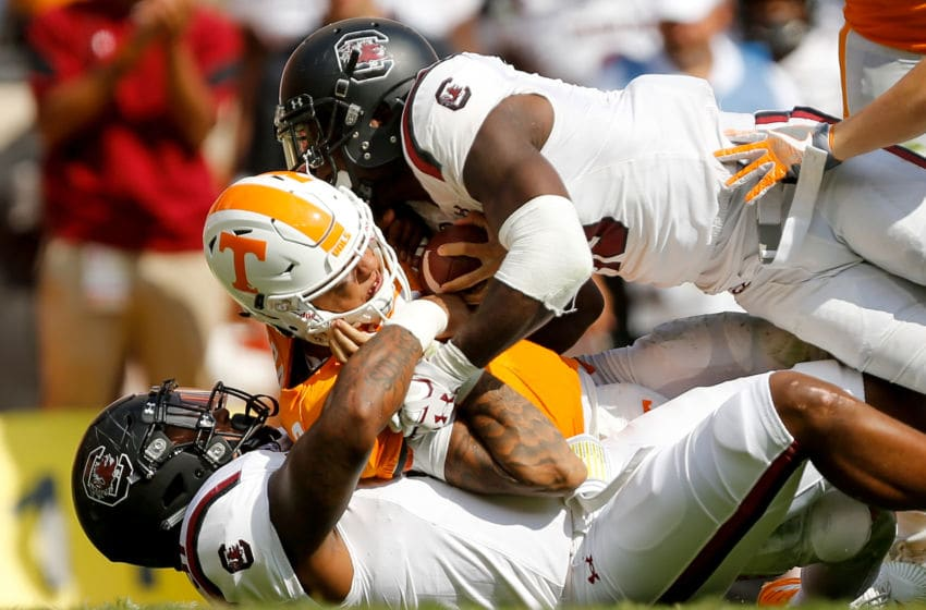 KNOXVILLE, TN - OCTOBER 14: Skai Moore #10 and Shameik Blackshear #91 of the South Carolina Gamecocks tackle Jarrett Guarantano #2 of the Tennessee Volunteers during the second half at Neyland Stadium on October 14, 2017 in Knoxville, Tennessee. South Carolina defeated Tennessee 15-9. (Photo by Michael Reaves/Getty Images)