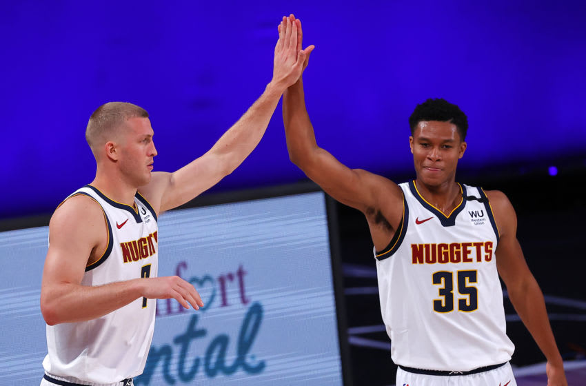 Mason Plumlee #7 celebrates with PJ Dozier #35 of the Denver Nuggets. (Photo by Kevin C. Cox/Getty Images)