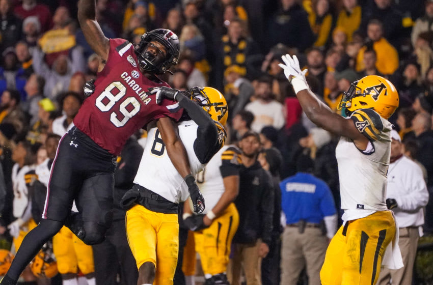Nov 9, 2019; Columbia, SC, USA; South Carolina Gamecocks wide receiver Bryan Edwards (89) reaches for a pass that would be intercepted by Appalachian State Mountaineers defensive back Josh Thomas (7) during the second half at Williams-Brice Stadium. Mandatory Credit: Jim Dedmon-USA TODAY Sports