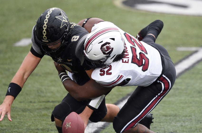 Vanderbilt quarterback Ken Seals (8) fumbles as he's hit by South Carolina defensive lineman Kingsley Enagbare (52) during the first quarter at Vanderbilt Stadium Saturday, Oct. 10, 2020 in Nashville, Tenn. Gw42703
