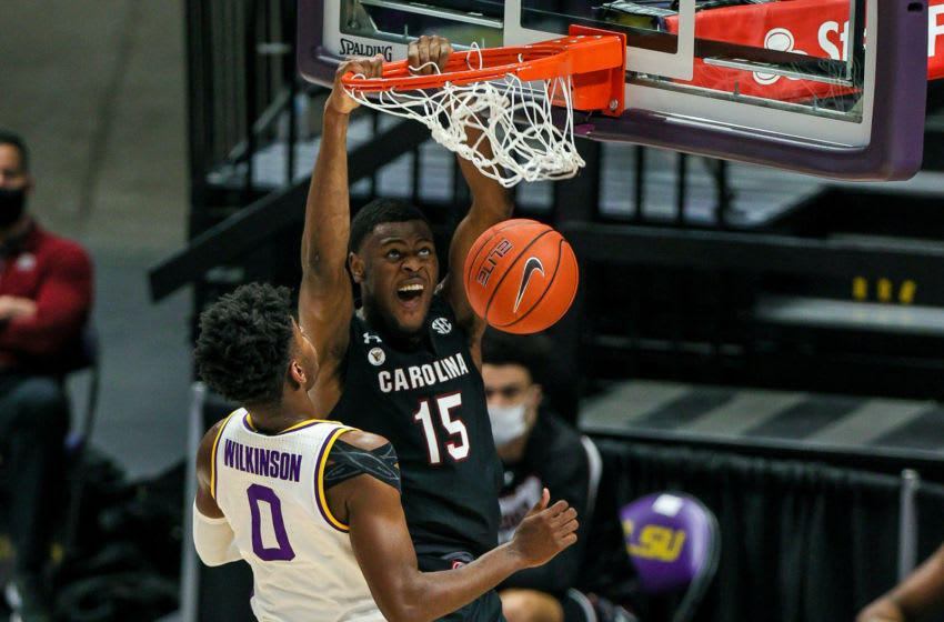 Jan 16, 2021; Baton Rouge, Louisiana, USA; South Carolina Gamecocks forward Wildens Leveque (15) dunks the ball against LSU Tigers forward Mwani Wilkinson (0) during the second half at the Pete Maravich Assembly Center. Mandatory Credit: Stephen Lew-USA TODAY Sports