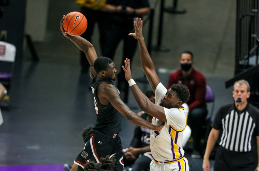 Jan 16, 2021; Baton Rouge, Louisiana, USA; South Carolina Gamecocks forward Keyshawn Bryant (24) is fouled going to the basket by LSU Tigers forward Darius Days (4) during the second half at the Pete Maravich Assembly Center. Mandatory Credit: Stephen Lew-USA TODAY Sports