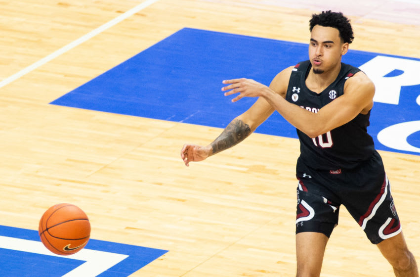 Mar 6, 2021; Lexington, Kentucky, USA; South Carolina Gamecocks forward Justin Minaya (10) passes the ball during the first half of the game against the Kentucky Wildcats at Rupp Arena at Central Bank Center. Mandatory Credit: Arden Barnes-USA TODAY Sports