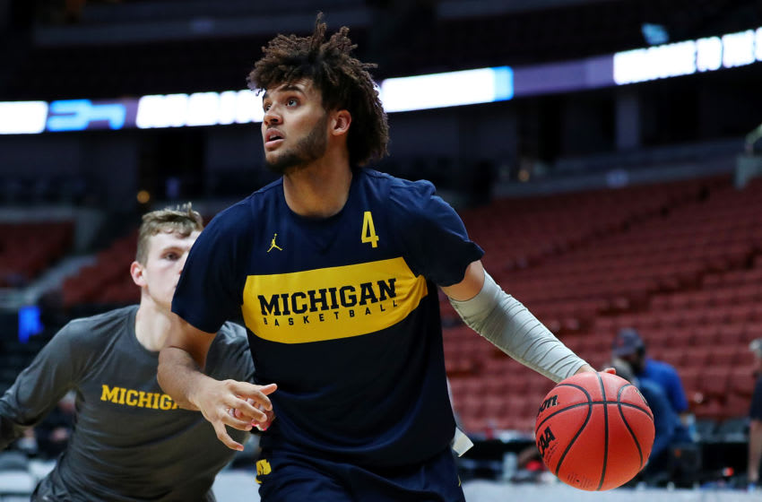 ANAHEIM, CALIFORNIA - MARCH 27: Isaiah Livers #4 of the Michigan Wolverines drives to the basket during a practice session ahead of the 2019 NCAA Men's Basketball Tournament West Regional at Honda Center on March 27, 2019 in Anaheim, California. (Photo by Yong Teck Lim/Getty Images)