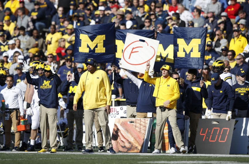 COLLEGE PARK, MD - NOVEMBER 02: Michigan Wolverines coaches signal plays from the sideline during a game against the Maryland Terrapins at Capital One Field at Maryland Stadium on November 2, 2019 in College Park, Maryland. Michigan defeated Maryland 38-7. (Photo by Joe Robbins/Getty Images)