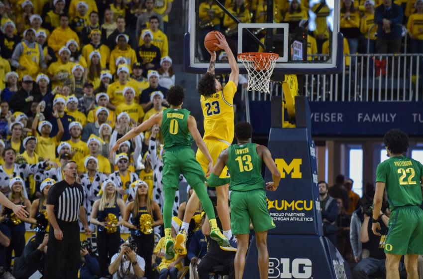 ANN ARBOR, MICHIGAN - DECEMBER 14: Brandon Johns, Jr. #23 of the Michigan Wolverines attempts a dunk during the first half of a college basketball game against the Oregon Ducks at The Crisler Center on December 14, 2019 in Ann Arbor, Michigan. (Photo by Aaron J. Thornton/Getty Images)