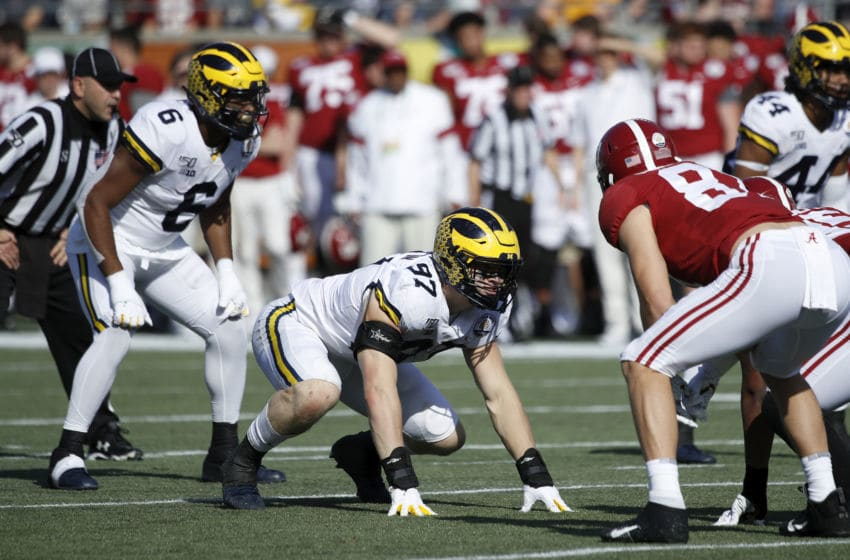 ORLANDO, FL - JANUARY 01: Aidan Hutchinson #97 of the Michigan Wolverines lines up on defense during the Vrbo Citrus Bowl against the Alabama Crimson Tide at Camping World Stadium on January 1, 2020 in Orlando, Florida. Alabama defeated Michigan 35-16. (Photo by Joe Robbins/Getty Images)