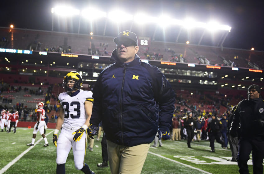 PISCATAWAY, NJ - NOVEMBER 10: Head coach Jim Harbaugh of the Michigan Wolverines runs off the field after the game against the Rutgers Scarlet Knights at HighPoint.com Stadium on November 10, 2018 in Piscataway, New Jersey. Michigan won 42-7. (Photo by Corey Perrine/Getty Images)