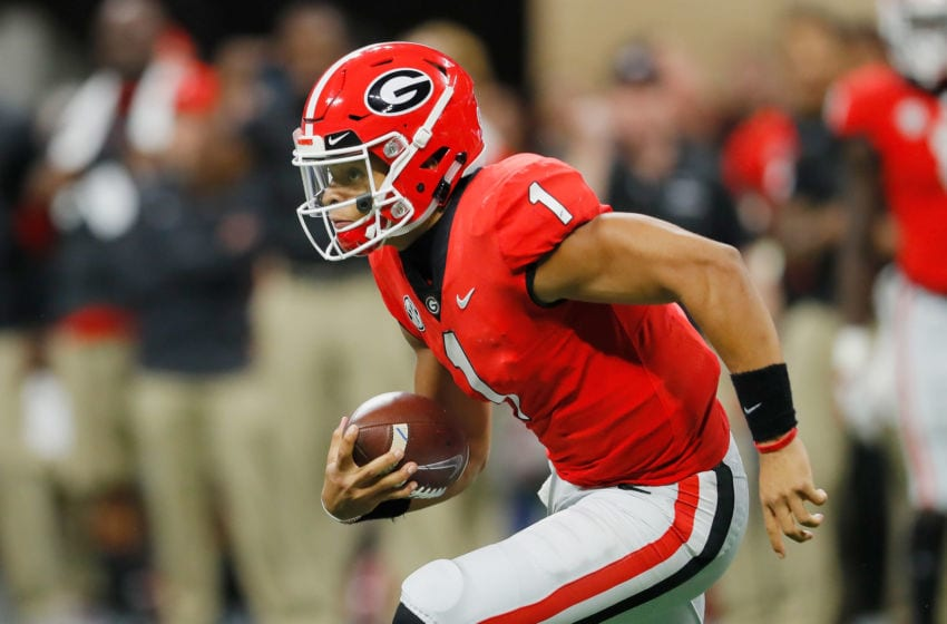 ATLANTA, GA - DECEMBER 01: Justin Fields #1 of the Georgia Bulldogs runs with the ball in the first half against the Alabama Crimson Tide during the 2018 SEC Championship Game at Mercedes-Benz Stadium on December 1, 2018 in Atlanta, Georgia. (Photo by Kevin C. Cox/Getty Images)