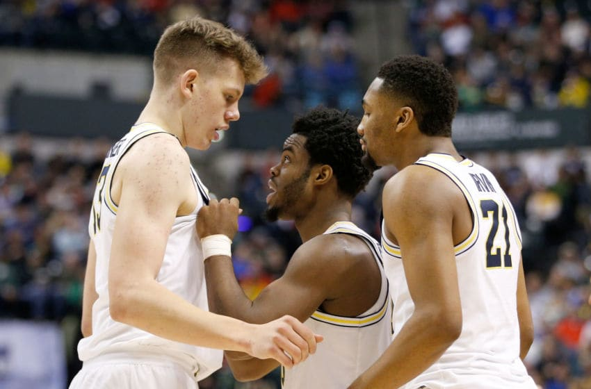 INDIANAPOLIS, IN - MARCH 17: Derrick Walton Jr. #10 of the Michigan Wolverines talks with Moritz Wagner #13 and Zak Irvin #21 against the Oklahoma State Cowboys during the first round of the 2017 NCAA Men's Basketball Tournament at Bankers Life Fieldhouse on March 17, 2017 in Indianapolis, Indiana. (Photo by Joe Robbins/Getty Images)