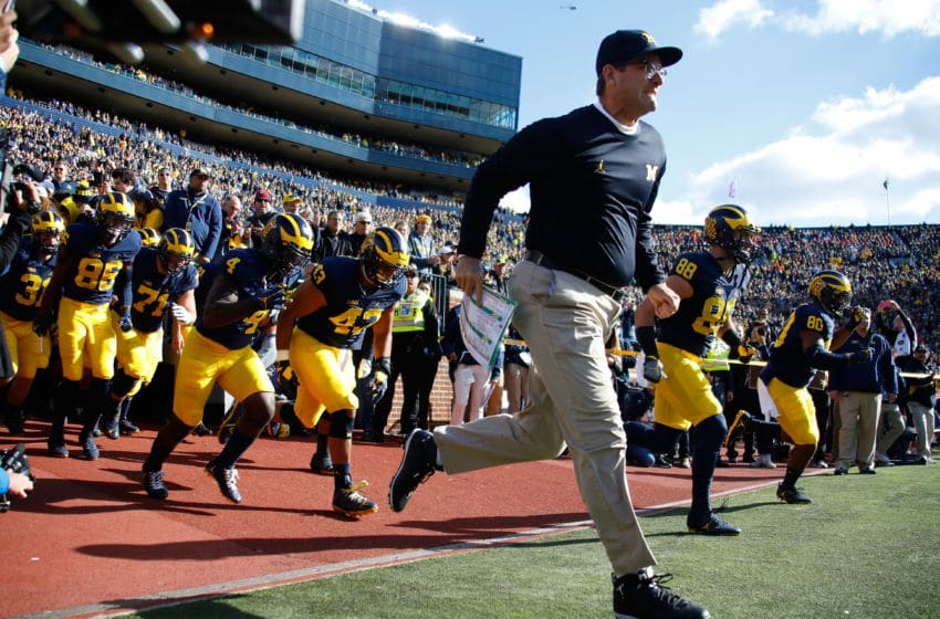 ANN ARBOR, MI - OCTOBER 22: Head coach Jim Harbaugh of the Michigan Wolverines leads the team onto the field prior to playing the Illinois Fighting Illini on October 22, 2016 at Michigan Stadium in Ann Arbor, Michigan. Michigan won the game 41-8. (Photo by Gregory Shamus/Getty Images)