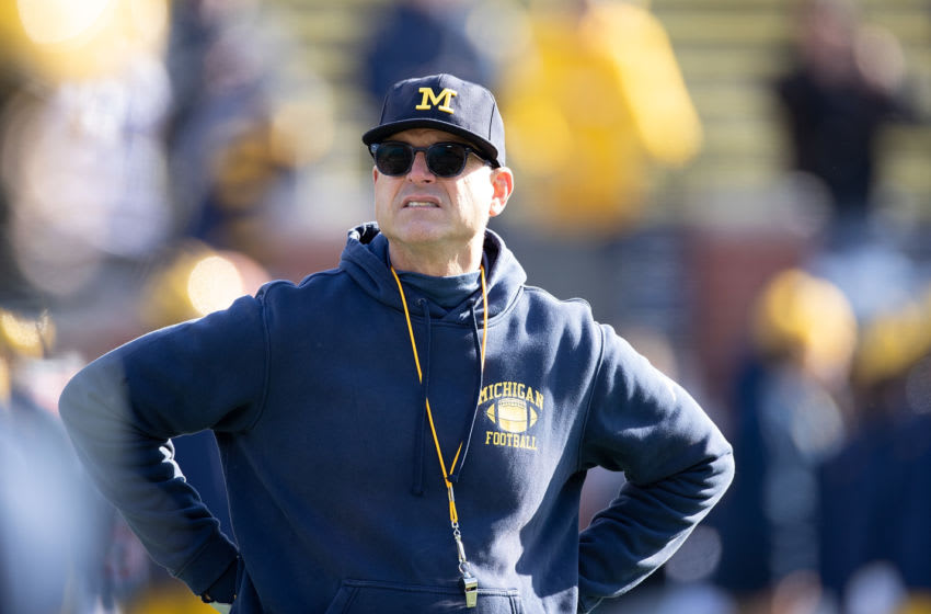ANN ARBOR, MI - NOVEMBER 16: Michigan Wolverines head football coach Jim Harbaugh watches the pregame warm ups prior to the start of the game against the Michigan State Spartans at Michigan Stadium on November 16, 2019 in Ann Arbor, Michigan. (Photo by Leon Halip/Getty Images)