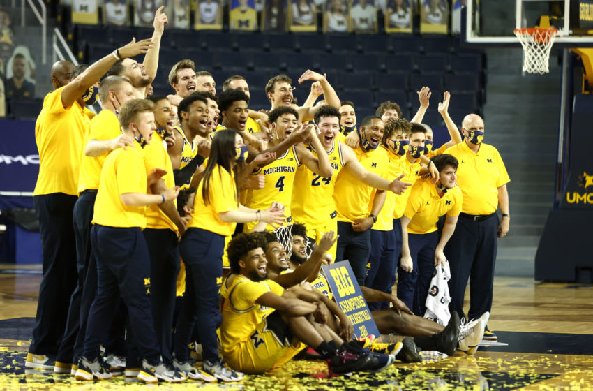 ANN ARBOR, MICHIGAN - MARCH 04: The Michigan Wolverines celebrate their 2021 Big Ten Championship after defeating the Michigan State Spartans 69-50 at Crisler Arena on March 04, 2021 in Ann Arbor, Michigan. (Photo by Gregory Shamus/Getty Images)
