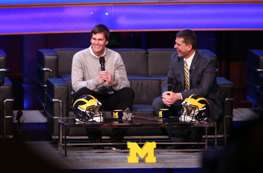 ANN ARBOR, MI - FEBRUARY 3: Tom Brady, former Michigan Wolverine and current NFL quarterback talks with Head coach Jim Harbaugh of the Michigan Wolverines during the Michigan Signing of the Stars event at Hill Auditorium on February 3, 2016 in Ann Arbor, Michigan. (Photo by Rey Del Rio/Getty Images)