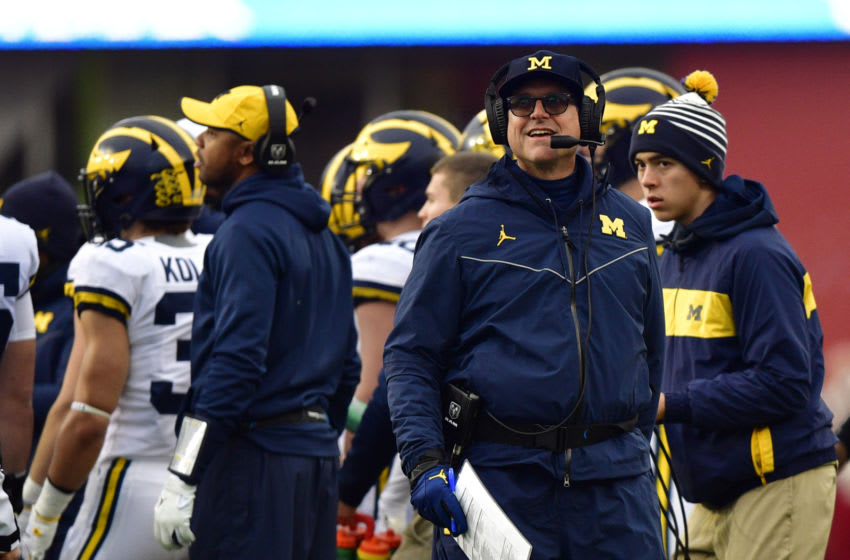 Nov 23, 2019; Bloomington, IN, USA; Michigan Wolverines head coach Jim Harbaugh looks up at the video board during the first quarter of the game against the Indiana Hoosiers at Memorial Stadium. Mandatory Credit: Marc Lebryk-USA TODAY Sports
