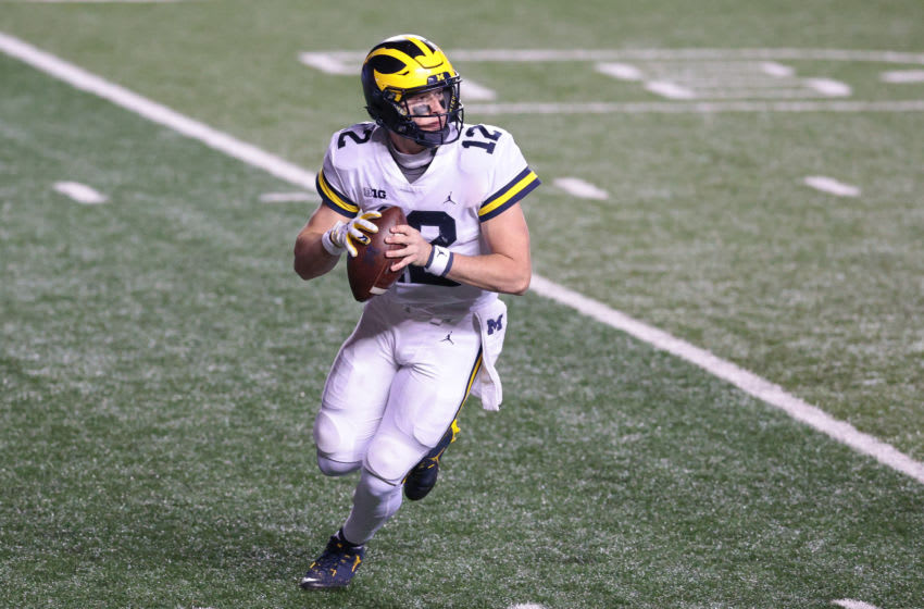 Nov 21, 2020; Piscataway, New Jersey, USA; Michigan Wolverines quarterback Cade McNamara (12) rolls out during the third quarter against the Rutgers Scarlet Knights at SHI Stadium. Mandatory Credit: Vincent Carchietta-USA TODAY Sports