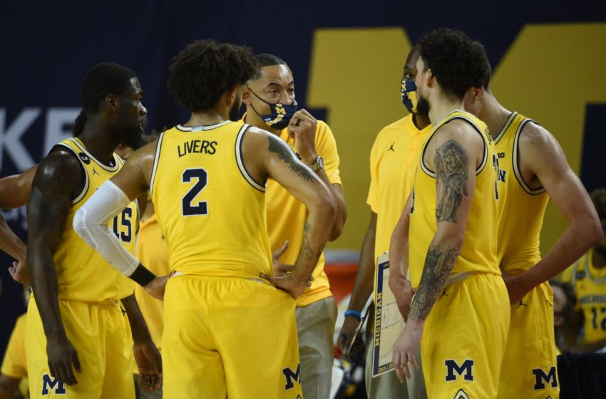 Dec 13, 2020; Ann Arbor, Michigan, USA; Michigan Wolverines head coach Juwan Howard (third from left) talks to his team during the second half against the Penn State Nittany Lions at Crisler Center. Mandatory Credit: Tim Fuller-USA TODAY Sports