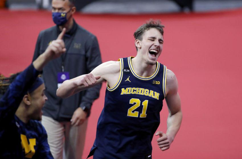 Feb 21, 2021; Columbus, Ohio, USA; Michigan Wolverines guard Franz Wagner (21) celebrates the 92-87 win over the Ohio State Buckeyes at Value City Arena. Mandatory Credit: Joseph Maiorana-USA TODAY Sports