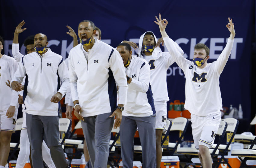 Feb 25, 2021; Ann Arbor, Michigan, USA; Michigan Wolverines head coach Juwan Howard and the bench reacts during the second half against the Iowa Hawkeyes at Crisler Center. Mandatory Credit: Rick Osentoski-USA TODAY Sports