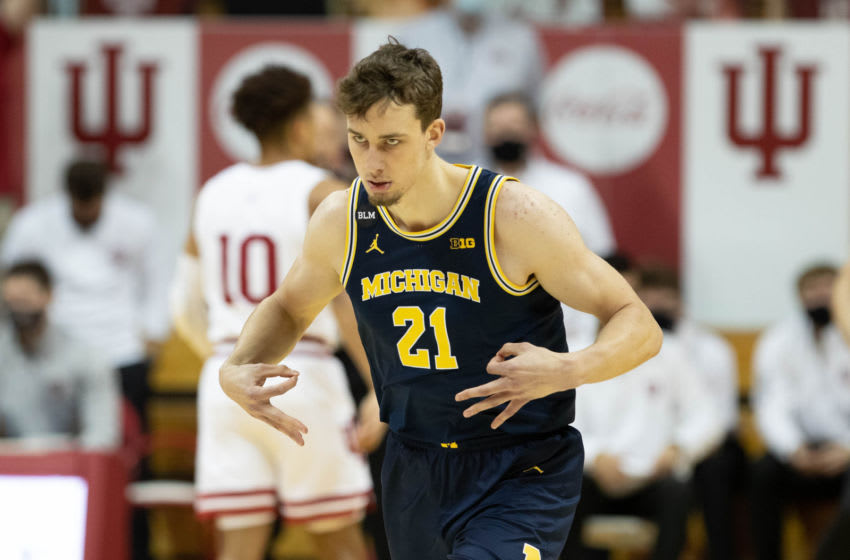 Feb 27, 2021; Bloomington, Indiana, USA; Michigan Wolverines guard Franz Wagner (21) celebrates a made three point basket in the first half against the Indiana Hoosiers at Simon Skjodt Assembly Hall. Mandatory Credit: Trevor Ruszkowski-USA TODAY Sports