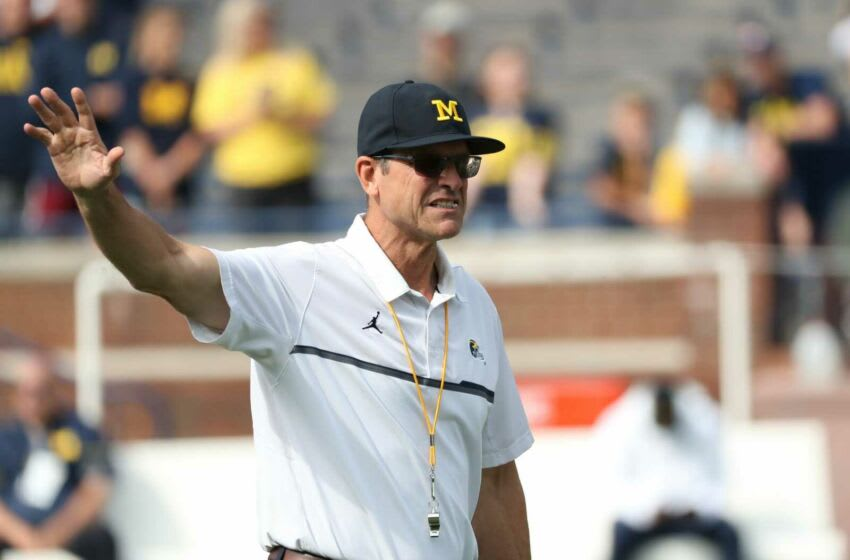 Michigan coach Jim Harbaugh on the field before the game against Western Michigan on Saturday, Sept. 4, 2021, in Ann Arbor. Mich West