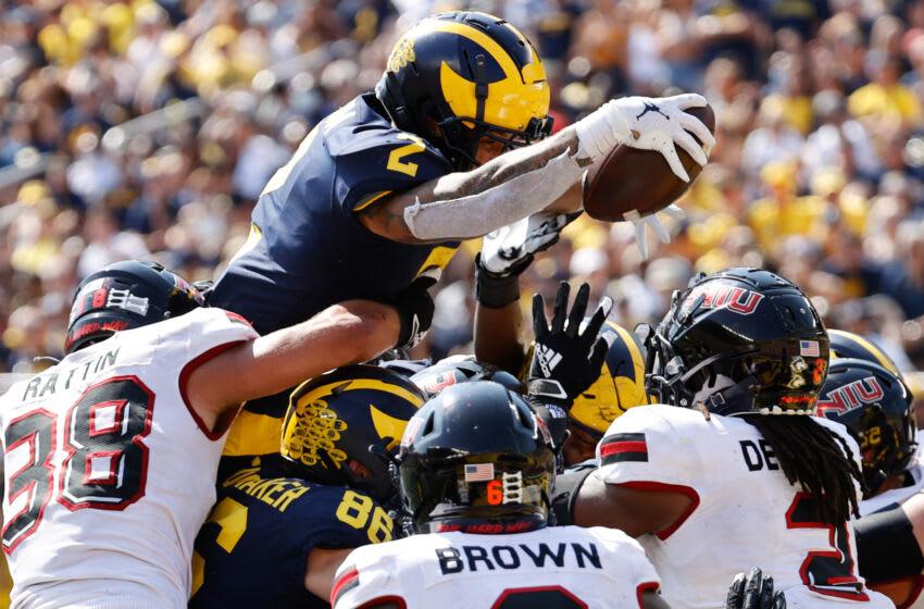 Sep 18, 2021; Ann Arbor, Michigan, USA; Michigan Wolverines running back Blake Corum (2) dives for touchdown in the second half against the Northern Illinois Huskies at Michigan Stadium. Mandatory Credit: Rick Osentoski-USA TODAY Sports