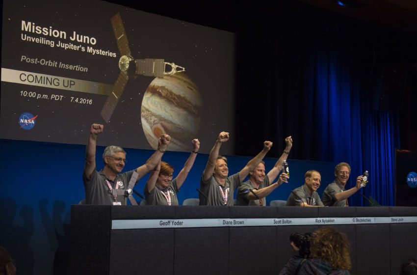 PASADENA, CA - JULY 4: In this NASA handout, Members of the Juno team celebrate at a press conference after they received confirmation from the Juno spacecraft that it had completed the engine burn and successfully entered into orbit around Jupiter, July 4, 2016 in Pasadena, CA. The Juno mission launched August 5, 2011 and will orbit the planet for 20 months to collect data on the planetary core, map the magnetic field, and measure the amount of water and ammonia in the atmosphere. (Photo by Aubrey Gemignani/NASA via Getty Images) MANDATORY CREDIT: (NASA/Aubrey Gemignani) Disposition: AFS 8/101 - Permanent