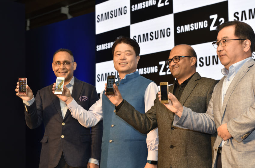 NEW DELHI, INDIA - AUGUST 23: (L TO R) Manu Sharma, Vice President, Mobile Business, Samsung India Electronics, H.C. Hong, President and CEO, Samsung South East Asia, Dipesh Shah, Managing Director, Samsung Research Instt., Ken Kang, Senior Vice President, Mobile Business, during the launch ceremony of Samsung Z2 Mobile, on August 23, 2016 in New Delhi, India. Built on the Tizen platform, Samsung Z2 caters to the requirements of new smartphone users transitioning from a feature phone. (Photo by Arvind Yadav/Hindustan Times via Getty Images)