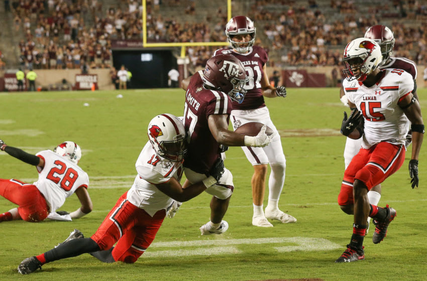 COLLEGE STATION, TEXAS - SEPTEMBER 14: Ainias Smith #17 of the Texas A&M Aggies scores on 13 yard pass as Anthony Ruffin #17 of the Lamar Cardinals is late on the play during the fourth quarter at Kyle Field on September 14, 2019 in College Station, Texas. (Photo by Bob Levey/Getty Images)