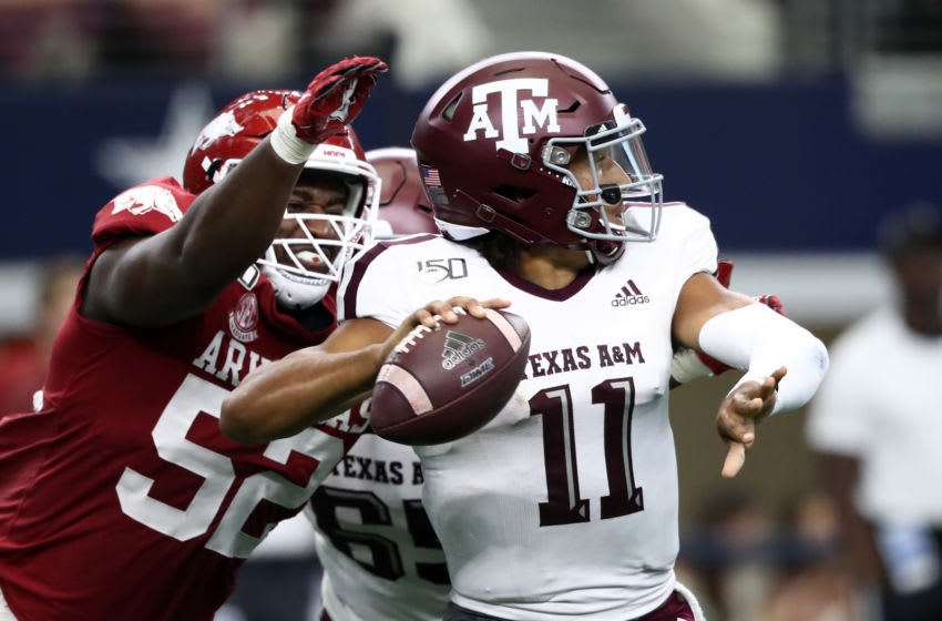 ARLINGTON, TEXAS - SEPTEMBER 28: T.J. Smith #52 of the Arkansas Razorbacks forces a fumble against Kellen Mond #11 of the Texas A&M Aggies in the second quarter during the Southwest Classic at AT&T Stadium on September 28, 2019 in Arlington, Texas. (Photo by Ronald Martinez/Getty Images)