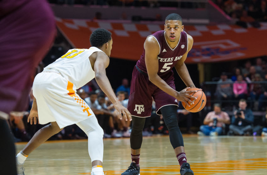 KNOXVILLE, TN - JANUARY 13: Texas A&M Aggies guard Savion Flagg (5) is guarded by Tennessee Volunteers guard Jalen Johnson (13) during a game between the Texas A&M Aggies and Tennessee Volunteers on January 13, 2018, at Thompson-Boling Arena in Knoxville, TN. (Photo by Bryan Lynn/Icon Sportswire via Getty Images)