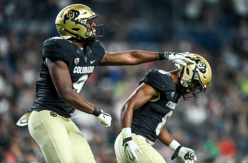 DENVER, CO - AUGUST 30: Running back Alex Fontenot #8 and tight end Jalen Harris #9 of the Colorado Buffaloes celebrate a third quarter Fontenot touchdown against the Colorado State Rams at Broncos Stadium at Mile High on August 30, 2019 in Denver, Colorado. (Photo by Dustin Bradford/Getty Images)