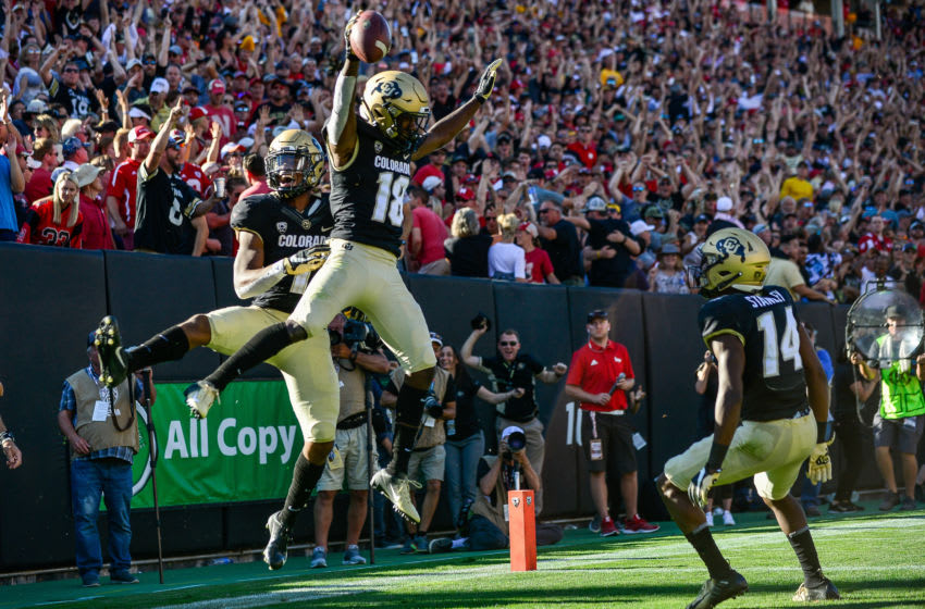 BOULDER, CO - SEPTEMBER 7: Wide receiver Tony Brown #18 of the Colorado Buffaloes celebrates a fourth quarter touchdown reception with wide receiver Wan'Dale Robinson #1 during a game against the Nebraska Cornhuskers at Folsom Field on September 7, 2019 in Boulder, Colorado. (Photo by Dustin Bradford/Getty Images)
