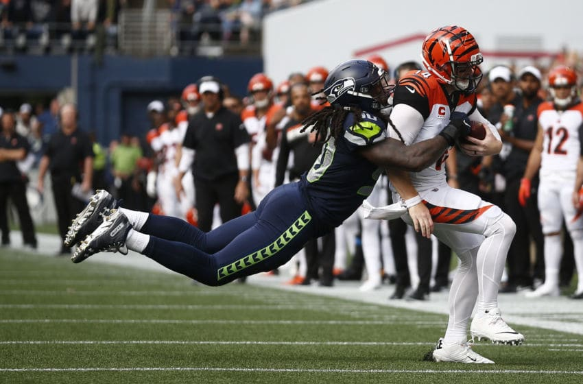 SEATTLE, WA - SEPTEMBER 08: Jadeveon Clowney #90 of the Seattle Seahawks tackles Andy Dalton #14 of the Cincinnati Bengals in the fourth quarter at CenturyLink Field on September 8, 2019 in Seattle, Washington. (Photo by Lindsey Wasson/Getty Images)