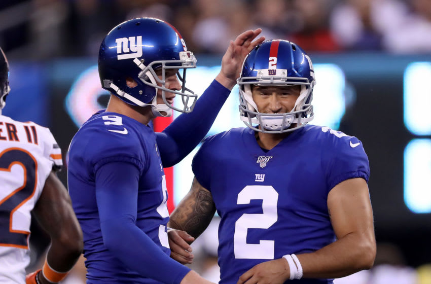 EAST RUTHERFORD, NEW JERSEY - AUGUST 16: Riley Dixon #9 congratulates teammate Aldrick Rosas #2 of the New York Giants the extra point in the first quarter against the Chicago Bears during a preseason game at MetLife Stadium on August 16, 2019 in East Rutherford, New Jersey. (Photo by Elsa/Getty Images)