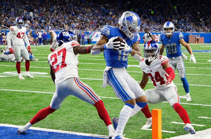 DETROIT, MI - OCTOBER 27: Kenny Golladay #19 of the Detroit Lions makes the touchdown catch as Deandre Baker #27 and Grant Haley #34 of the New York Giants defend during the third quarter of the game at Ford Field on October 27, 2019 in Detroit, Michigan. Detroit defeated New York 31-26. (Photo by Leon Halip/Getty Images)