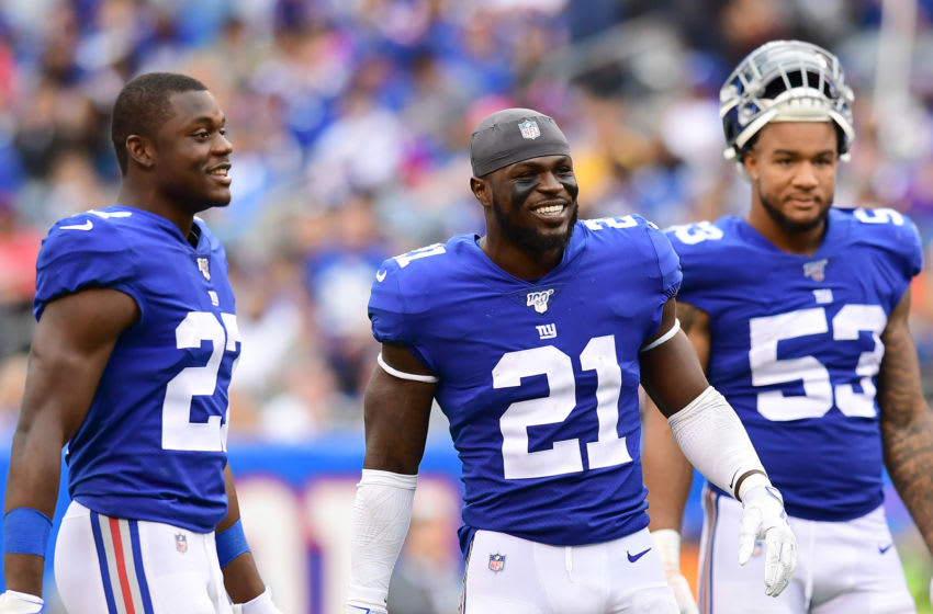 EAST RUTHERFORD, NEW JERSEY - OCTOBER 06: Jabrill Peppers #21, Oshane Ximines #53 and Deandre Baker #27 of the New York Giants react as a play is being reviewed during their game against the Minnesota Vikings at MetLife Stadium on October 06, 2019 in East Rutherford, New Jersey. (Photo by Emilee Chinn/Getty Images)