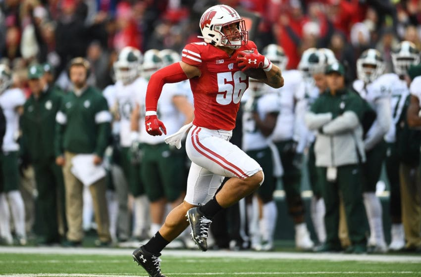 MADISON, WISCONSIN - OCTOBER 12: Zack Baun #56 of the Wisconsin Badgers returns an interception for a touchdown during the second half of a game against the Michigan State Spartans at Camp Randall Stadium on October 12, 2019 in Madison, Wisconsin. (Photo by Stacy Revere/Getty Images)