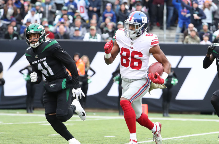 EAST RUTHERFORD, NEW JERSEY - NOVEMBER 10: Darius Slayton #86 of the New York Giants scores his second touchdown in the second quarter against Matthias Farley #41 of the New York Jets during their game at MetLife Stadium on November 10, 2019 in East Rutherford, New Jersey. (Photo by Al Bello/Getty Images)