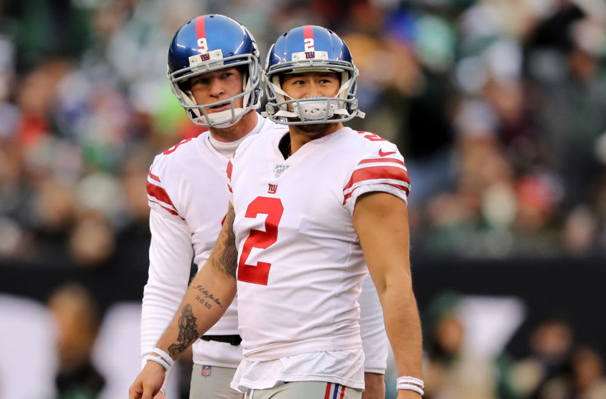 EAST RUTHERFORD, NEW JERSEY - NOVEMBER 10: Aldrick Rosas #2 of the New York Giants reacts after he missed the extra point as teammate Riley Dixon #9 looks on in the second half against the New York Jets at MetLife Stadium on November 10, 2019 in East Rutherford, New Jersey.The New York Jets defeated the New York Giants 34-27. (Photo by Elsa/Getty Images)