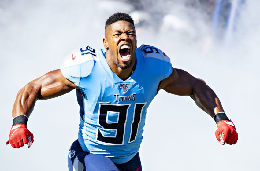 NASHVILLE, TN - NOVEMBER 10: Cameron Wake #91 of the Tennessee Titans runs onto the field with soldiers before a game against the Kansas City Chiefs at Nissan Stadium on November 10, 2019 in Nashville, Tennessee. The Titans defeated the Chiefs 35-32. (Photo by Wesley Hitt/Getty Images)