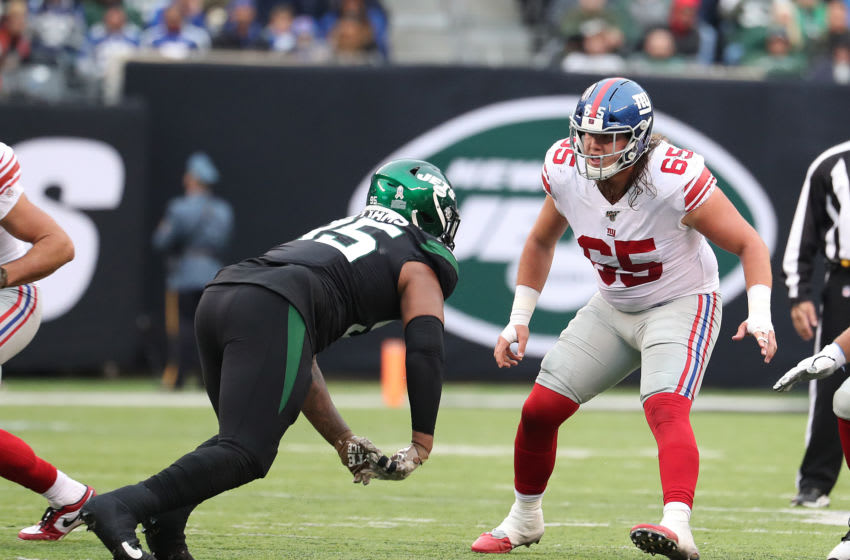 EAST RUTHERFORD, NEW JERSEY - NOVEMBER 10: Nick Gates #65 of the New York Giants in action against the New York Jsets during their game at MetLife Stadium on November 10, 2019 in East Rutherford, New Jersey. (Photo by Al Bello/Getty Images)