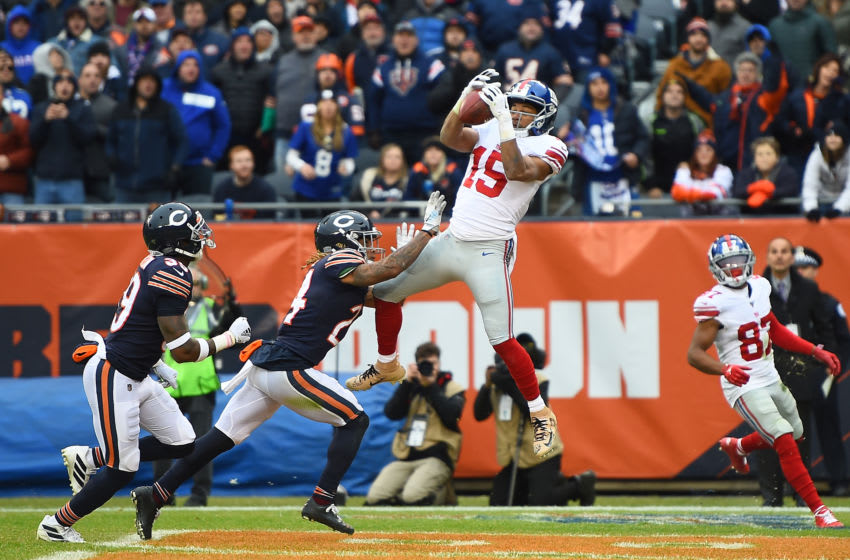 CHICAGO, ILLINOIS - NOVEMBER 24: Golden Tate #15 of the New York Giants catches a pass for a touchdown in front of Buster Skrine #24 of the Chicago Bears during the second half of a game at Soldier Field on November 24, 2019 in Chicago, Illinois. (Photo by Stacy Revere/Getty Images)