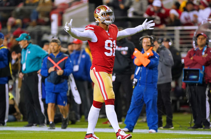 SANTA CLARA, CALIFORNIA - DECEMBER 21: Arik Armstead #91 of the San Francisco 49ers celebrates after making a tackle against the Los Angeles Rams during the first half of an NFL football game at Levi's Stadium on December 21, 2019 in Santa Clara, California. (Photo by Thearon W. Henderson/Getty Images)