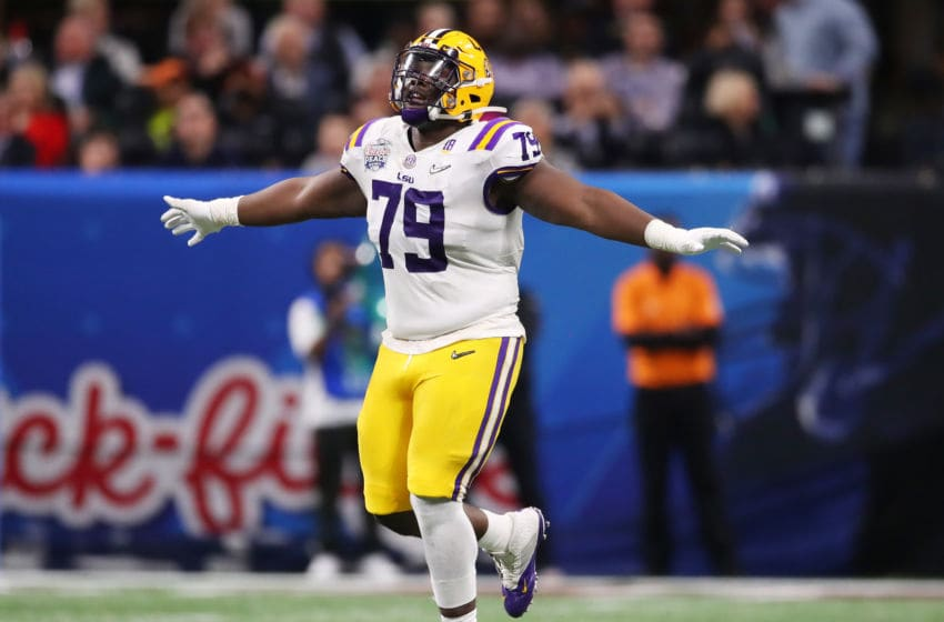 ATLANTA, GEORGIA - DECEMBER 28: Center Lloyd Cushenberry III #79 of the LSU Tigers celebrates during the game against the Oklahoma Sooners in the Chick-fil-A Peach Bowl at Mercedes-Benz Stadium on December 28, 2019 in Atlanta, Georgia. (Photo by Gregory Shamus/Getty Images)