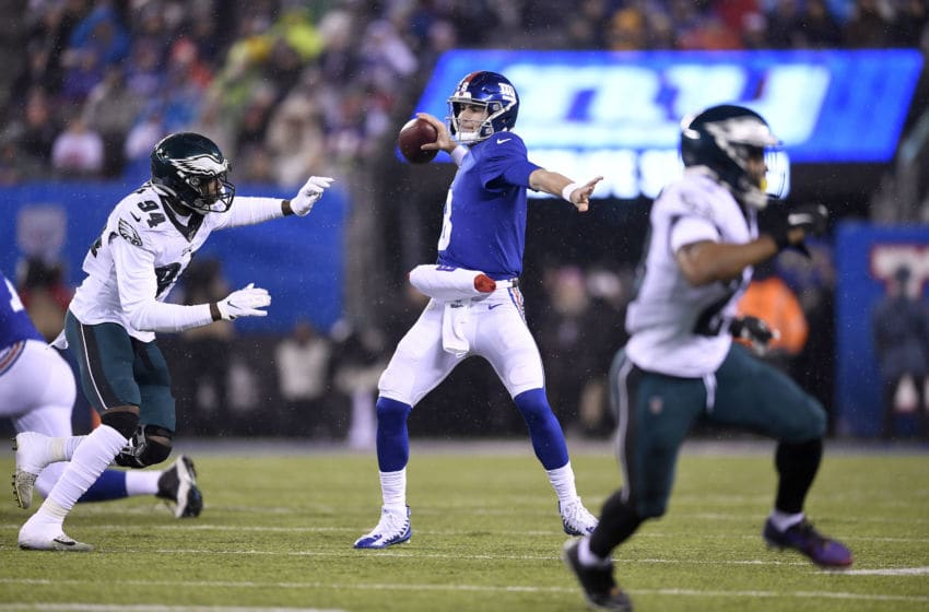 EAST RUTHERFORD, NEW JERSEY - DECEMBER 29: Daniel Jones #8 of the New York Giants looks to throw a pass against Josh Sweat #94 of the Philadelphia Eagles during the second quarter in the game at MetLife Stadium on December 29, 2019 in East Rutherford, New Jersey. (Photo by Sarah Stier/Getty Images)