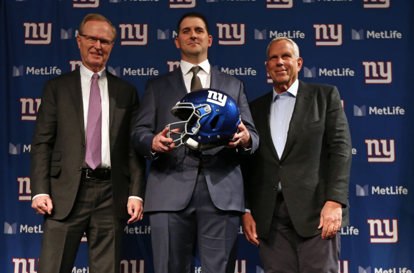 EAST RUTHERFORD, NJ - JANUARY 09: New York Giants new head coach Joe Judge, center, poses for photographs with team CEO John Mara, left, chairman and executive vice president Steve Tisch, right, after a news conference at MetLife Stadium on January 9, 2020 in East Rutherford, New Jersey. (Photo by Rich Schultz/Getty Images)