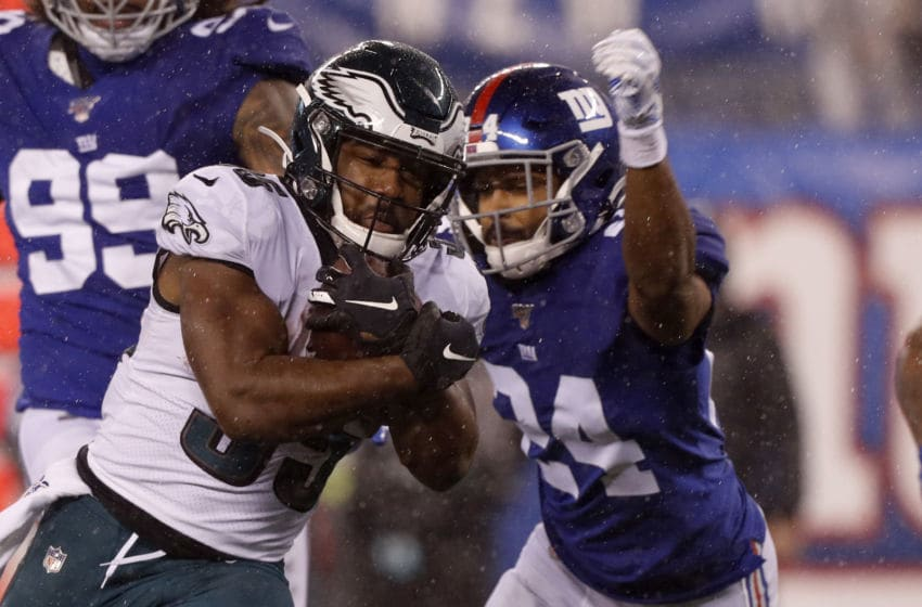 EAST RUTHERFORD, NEW JERSEY - DECEMBER 29: (NEW YORK DAILIES OUT) Boston Scott #35 of the Philadelphia Eagles in action against Julian Love #24 of the New York Giants at MetLife Stadium on December 29, 2019 in East Rutherford, New Jersey. The Eagles defeated the Giants 34-17. (Photo by Jim McIsaac/Getty Images)