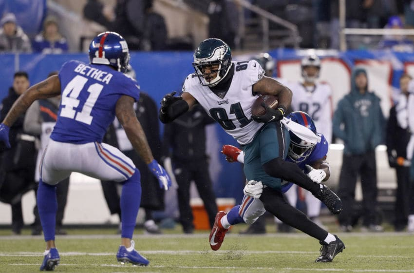 EAST RUTHERFORD, NEW JERSEY - DECEMBER 29: (NEW YORK DAILIES OUT) Josh Perkins #81 of the Philadelphia Eagles in action against Michael Thomas #31 and Antoine Bethea #41 of the New York Giants at MetLife Stadium on December 29, 2019 in East Rutherford, New Jersey. The Eagles defeated the Giants 34-17. (Photo by Jim McIsaac/Getty Images)