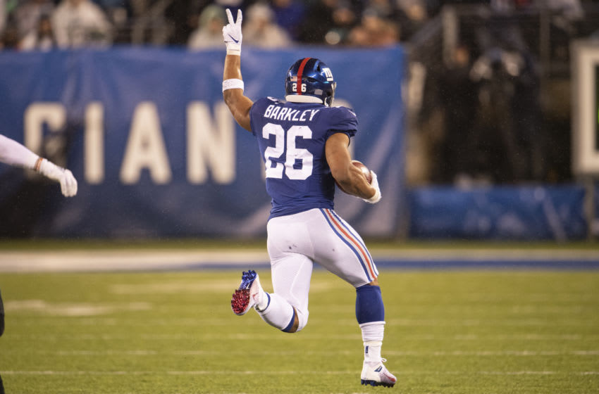 EAST RUTHERFORD, NJ - DECEMBER 29: Saquon Barkley #26 of the New York Giants runs the ball at Metlife Stadium on December 29, 2019 in East Rutherford, New Jersey. (Photo by Benjamin Solomon/Getty Images)